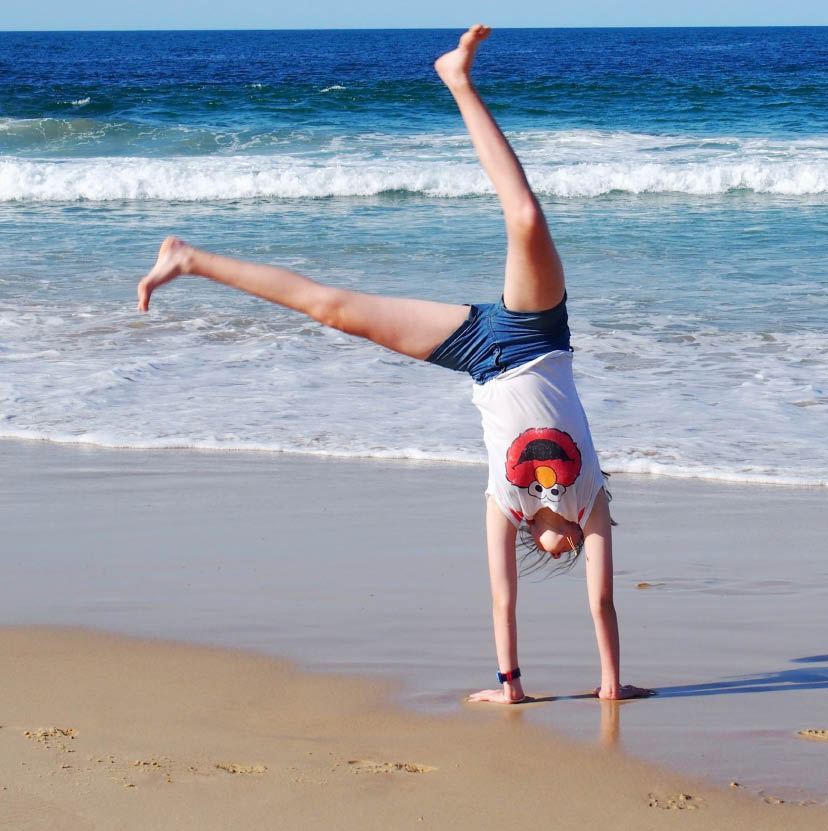 Running and Cartwheels at the Beach